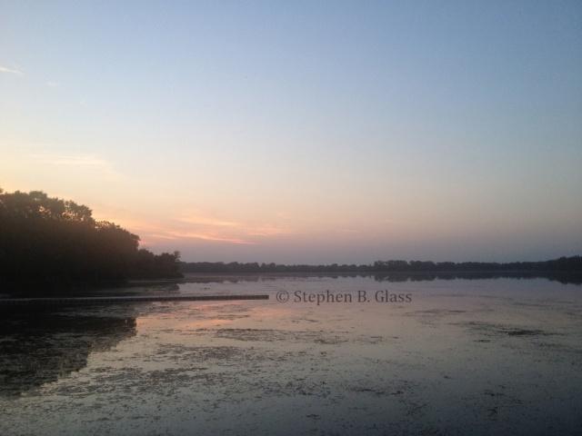Sunrise on Lake Wingra from the dock at Wingra Park.