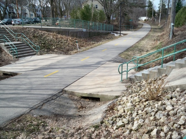 The project site at Prospect and the South West Bike Path as it appeared in March, 2010, before the community-based restoration work began.  Photo by Sandy Stark.