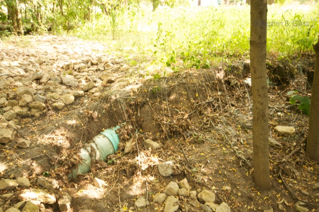 Exposed water line in the Cherokee Drive storm water ditch behind Thoreau School and Nakoma Park
