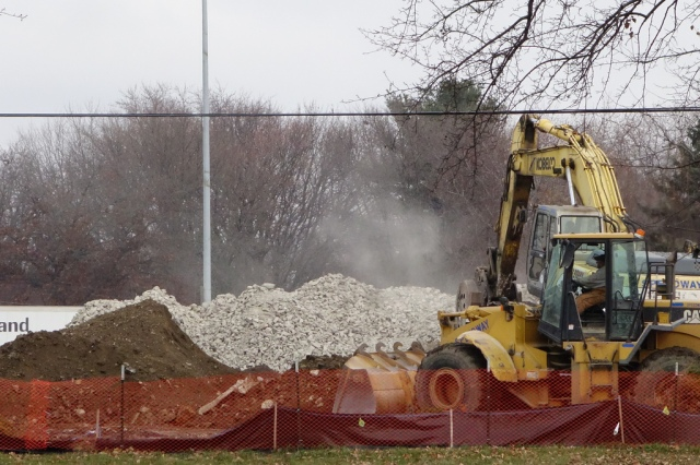 Silica dust rises from the Verona Road interchange staging area.