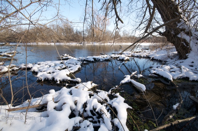 Snow-covered beaver dam on the shore of Ho-Nee-Um Pond.